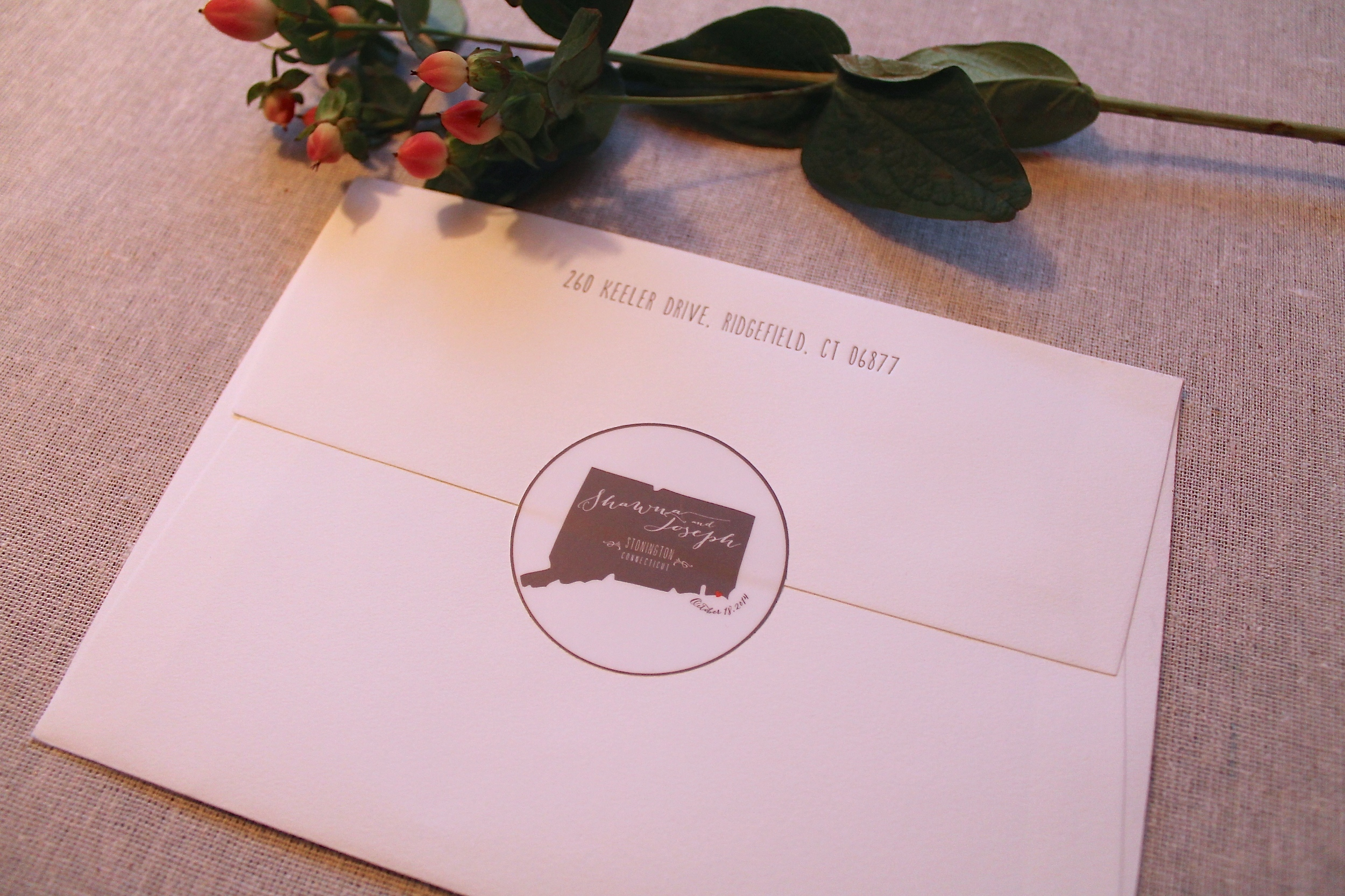Each Save the Date was sealed with a custom wedding logo decal.