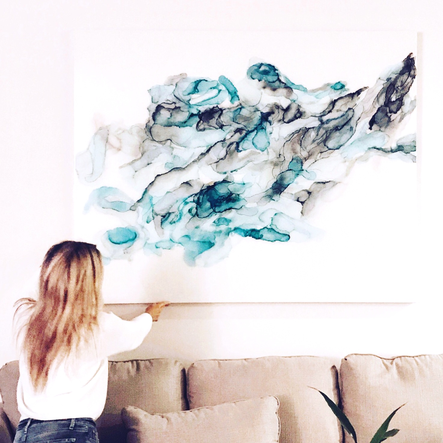 """Sherry Michelle installing """"Thoughts"""", a special order commission in a client's home 2018  60"""" x 48"""" x 2"""""""