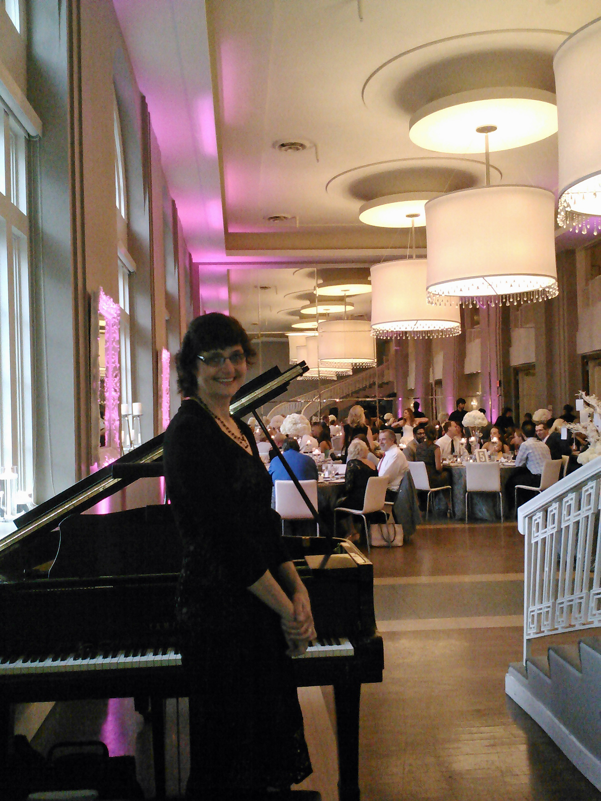 Sharon loved creating a romantic musical atmosphere on the grand piano for the newly married couple and their guests in the Boulevard Room at the Calhoun Beach Club.