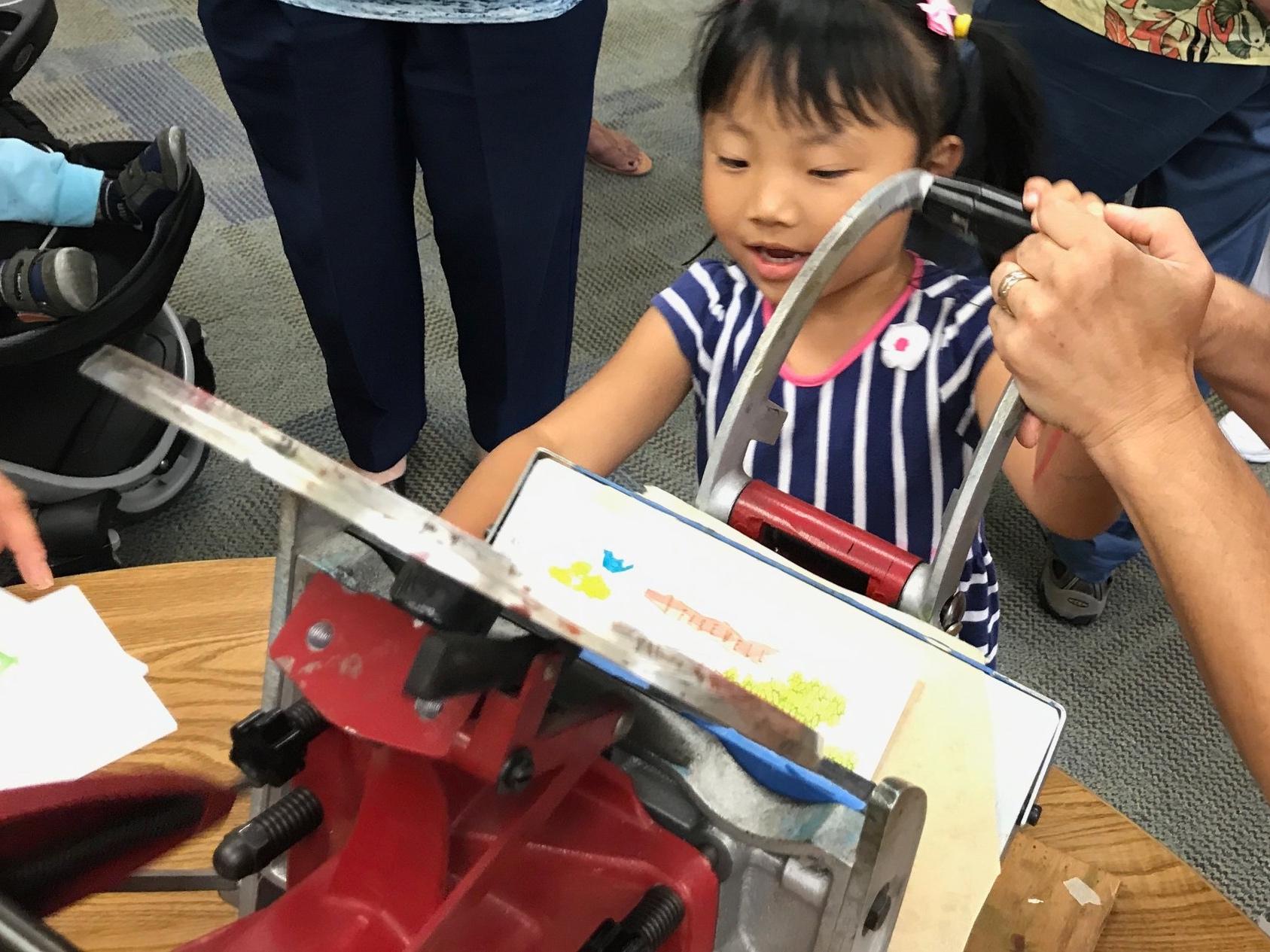 little girl with letterpress.jpg