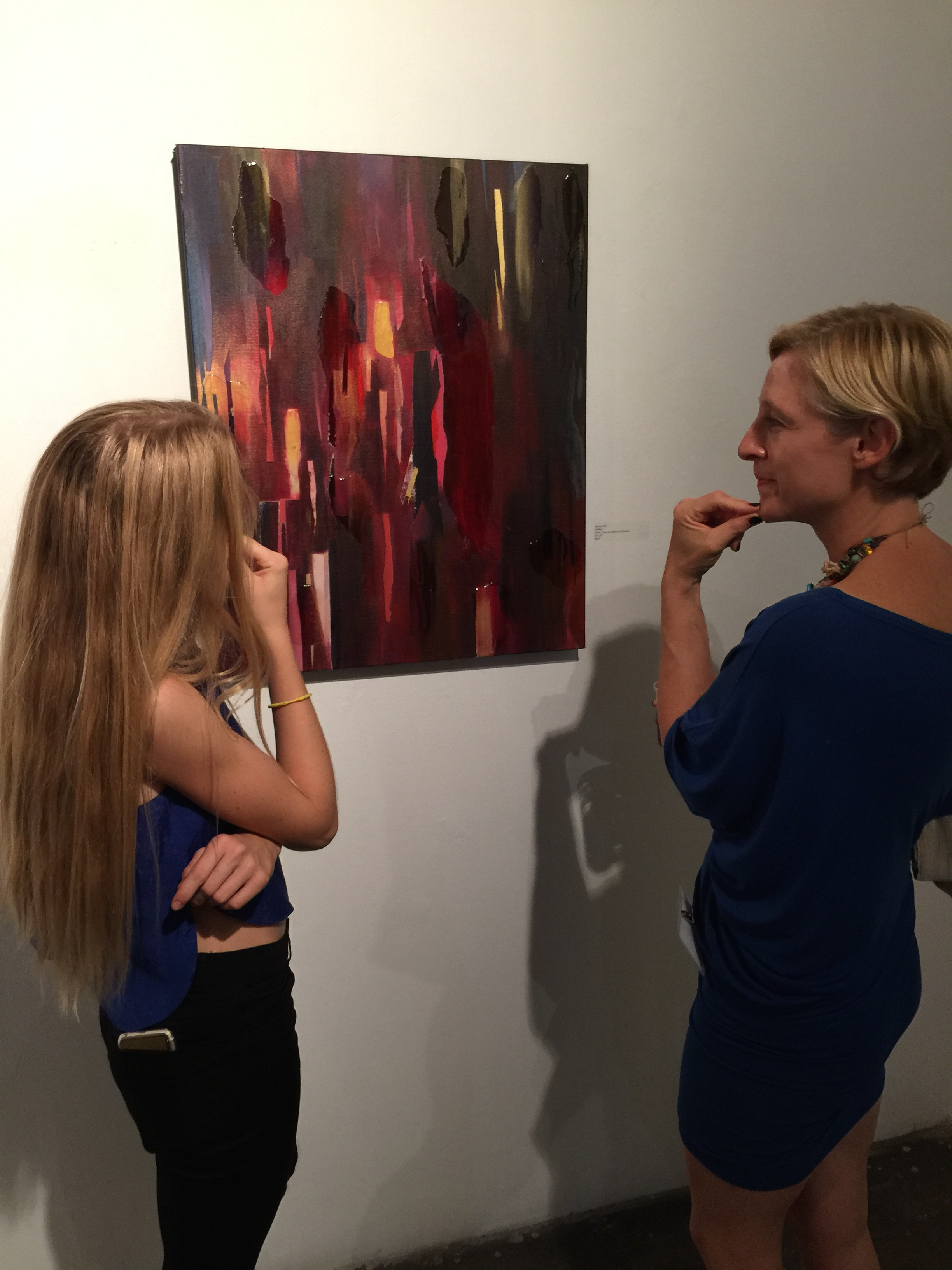 Amber and I thoughtfully examining my painting at Opposite of Algebra Exhibition