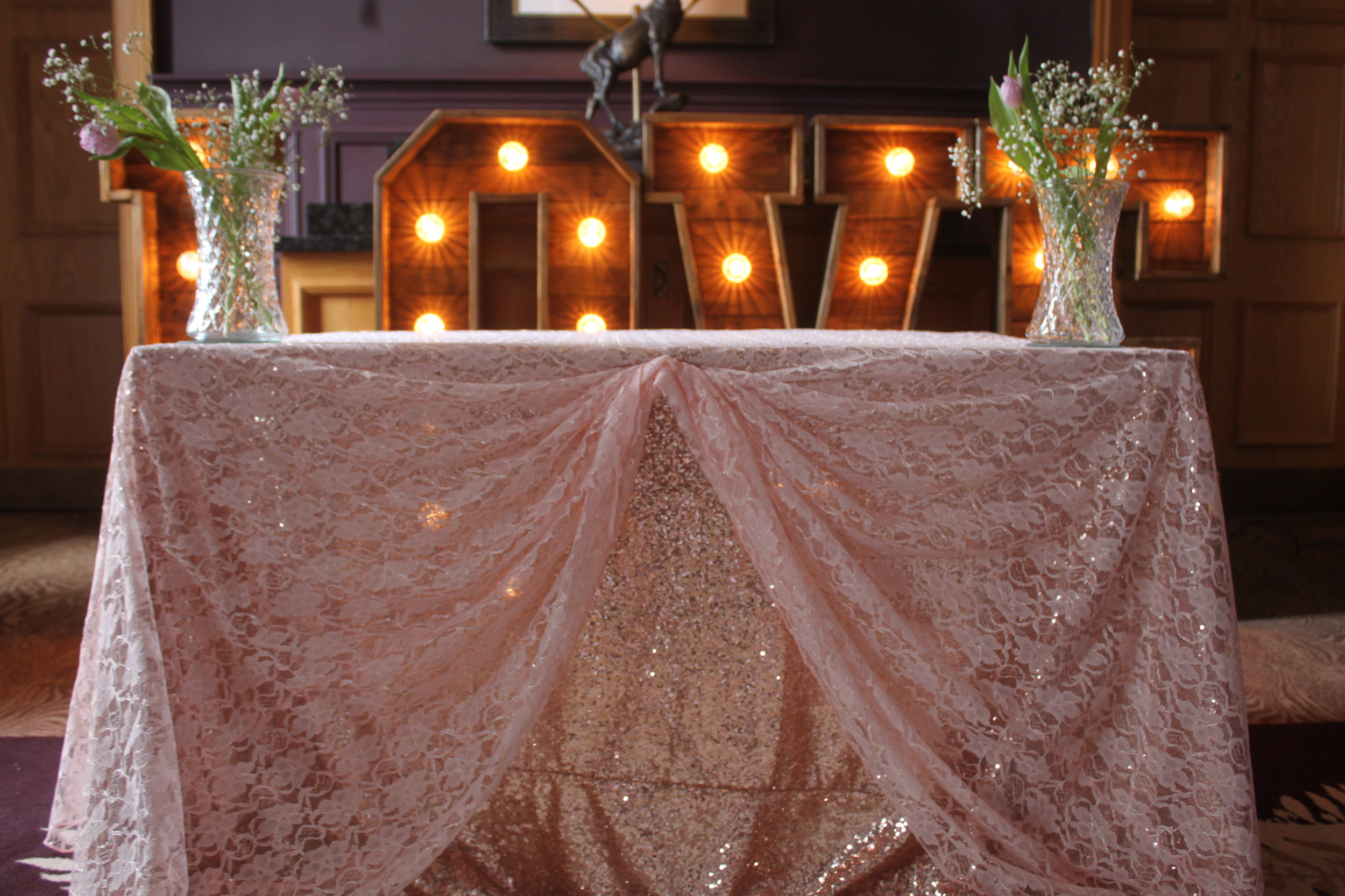 Cake & Registry - Cover your cake and registry table in style with our choice of stylish coverings. Choose from LED skirting, lace and sequin covers in a choice of colours and styles.Hire from only £40