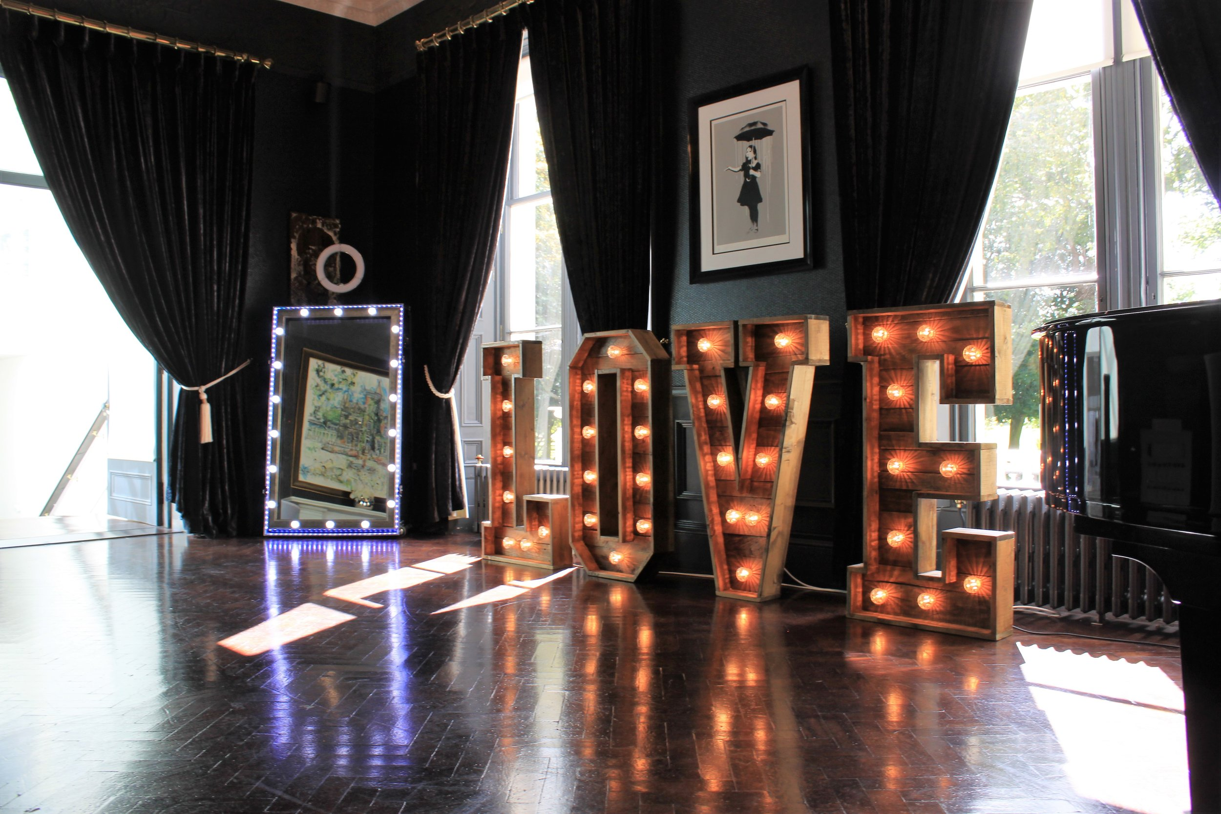 Rustic LOVE - Our unique rustic LOVE letters make the perfect addition to your wedding day. Complete with warm carnival lights our huge individual letters make an amazing backdrop for pictures.Hire for only £150.