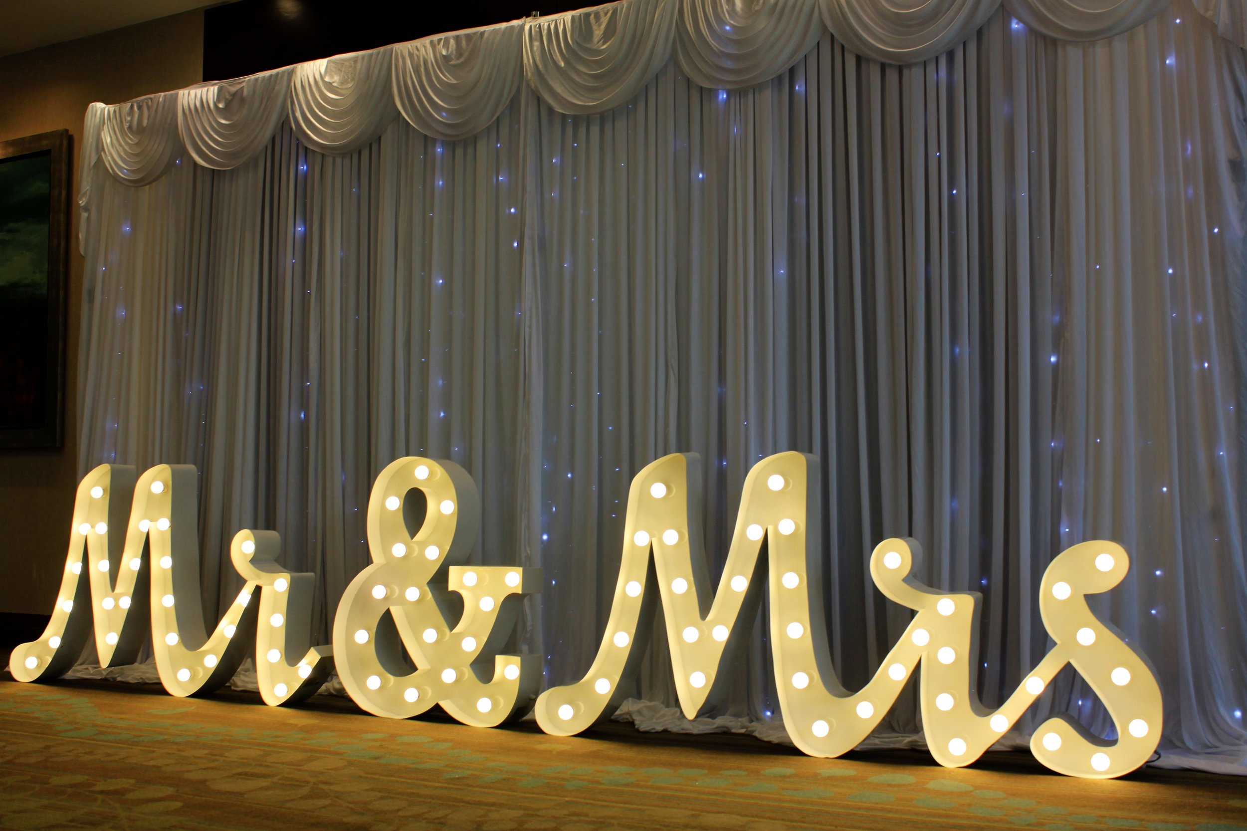 Luxury Mr&Mrs - Our luxury metal signature Mr & Mrs letters transform any wedding and really stand out. Sitting 3ft high and over 6 metres in length these letters give out an impressive 4,000 watts of beaming Hollywood style light!Hire for only £150.