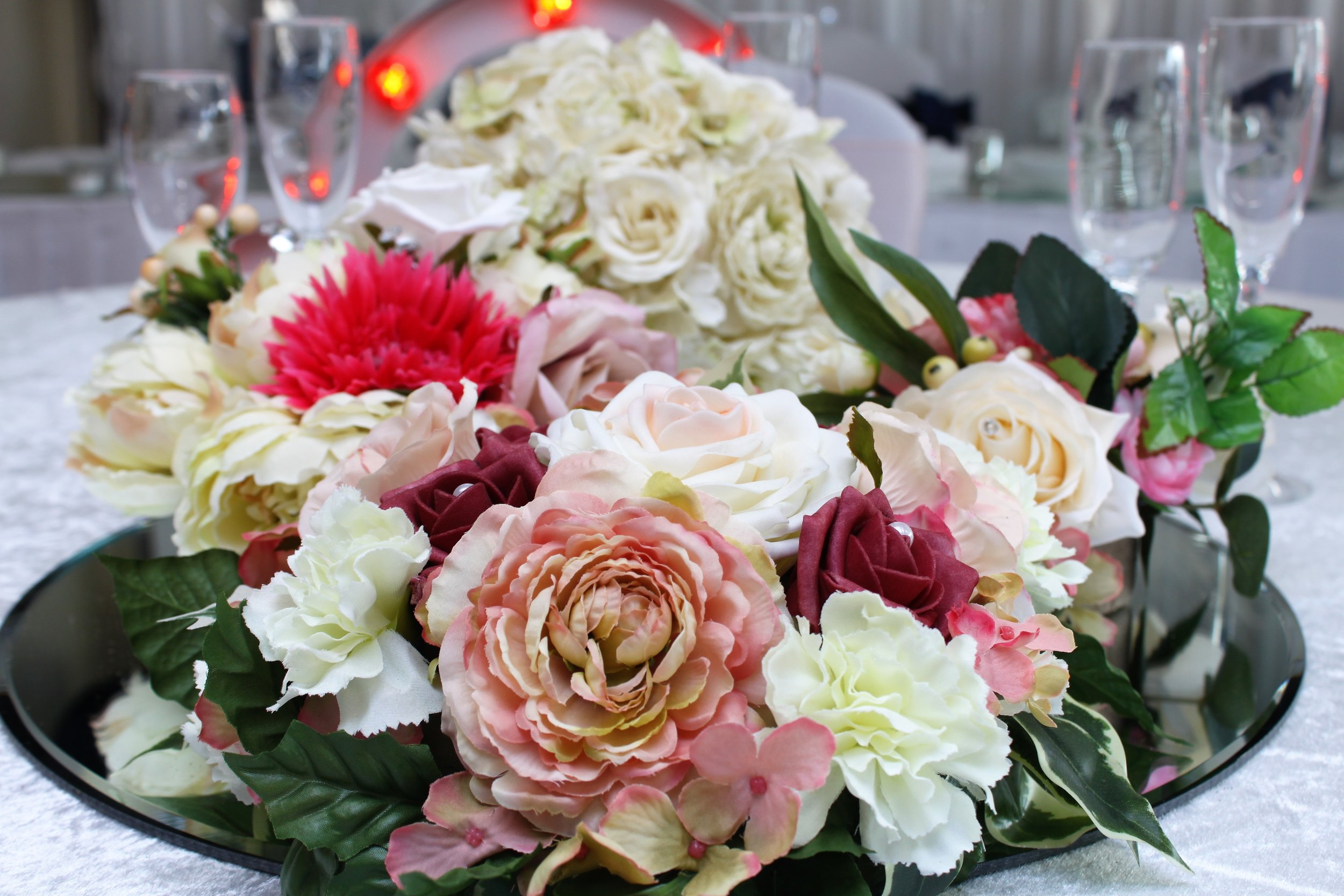 Artificial Flowers - We specialise in providing a stunning range of artificial flowers that provide a cost effective alternative to fresh flowers. Can be used to dress table centrepieces, lanterns and vases to match your colour theme.Hire from only £10