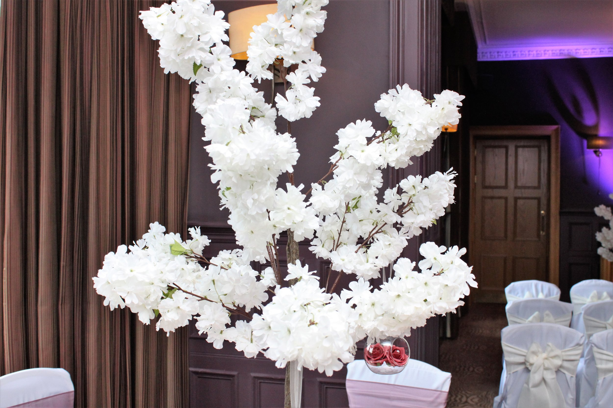 Cherry Blossom - A collection of stunning white cherry blossom trees that stand an impressive 4ft tall. Our trees create the perfect table centrepiece and transform any venue. 6ft blossom trees are also available as a matching set!From only £35 each or hire 10 for £300!