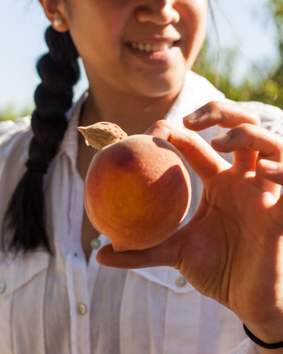 Zoe Wong, co-founder of  Cerplus  is on a mission to reduce food waste. Appropriately enough, she was finding all the ugly fruits including this one. It had the pit sticking out.