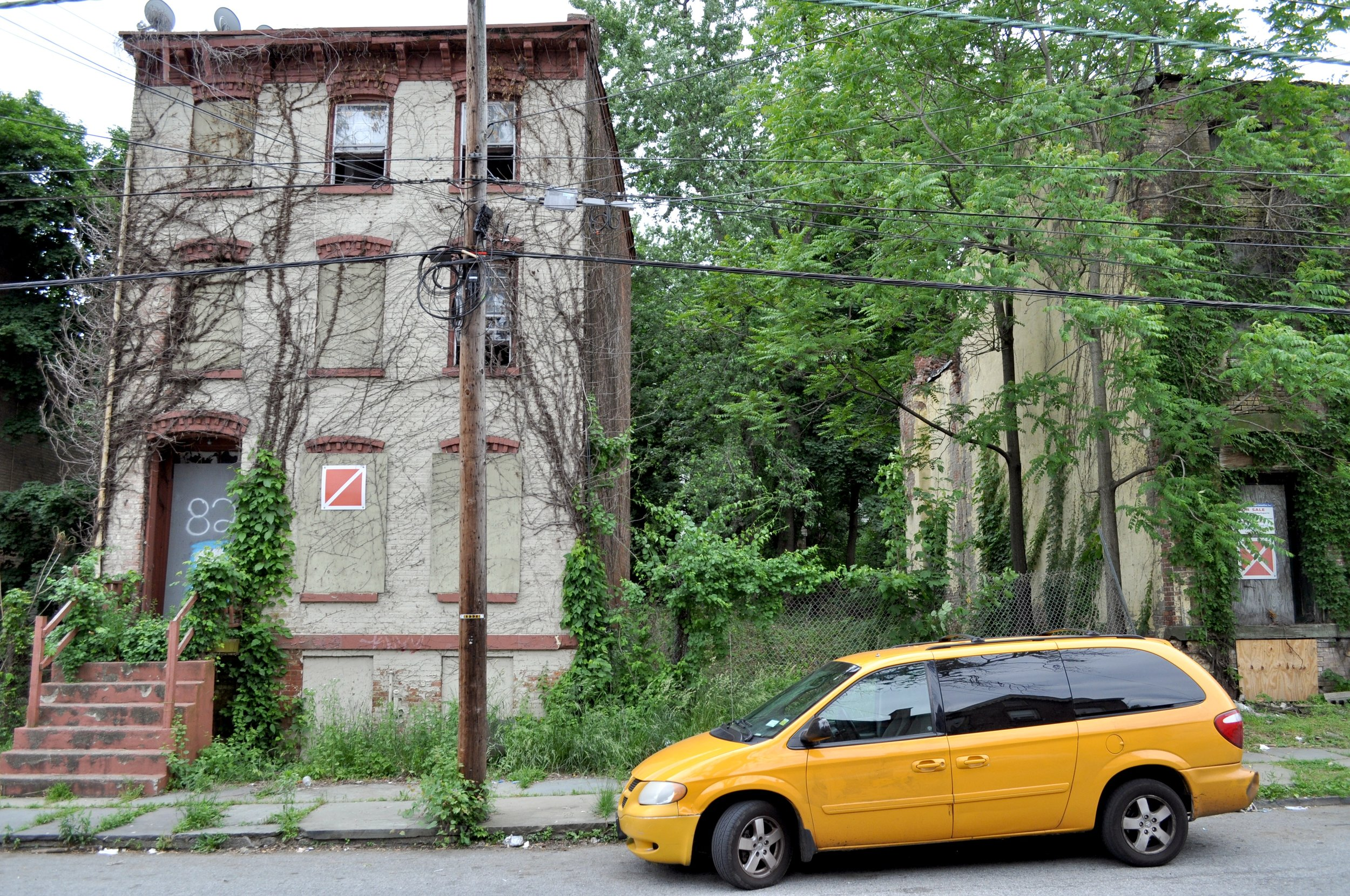 Taxi Van With Abandoned Buildings T.JPG