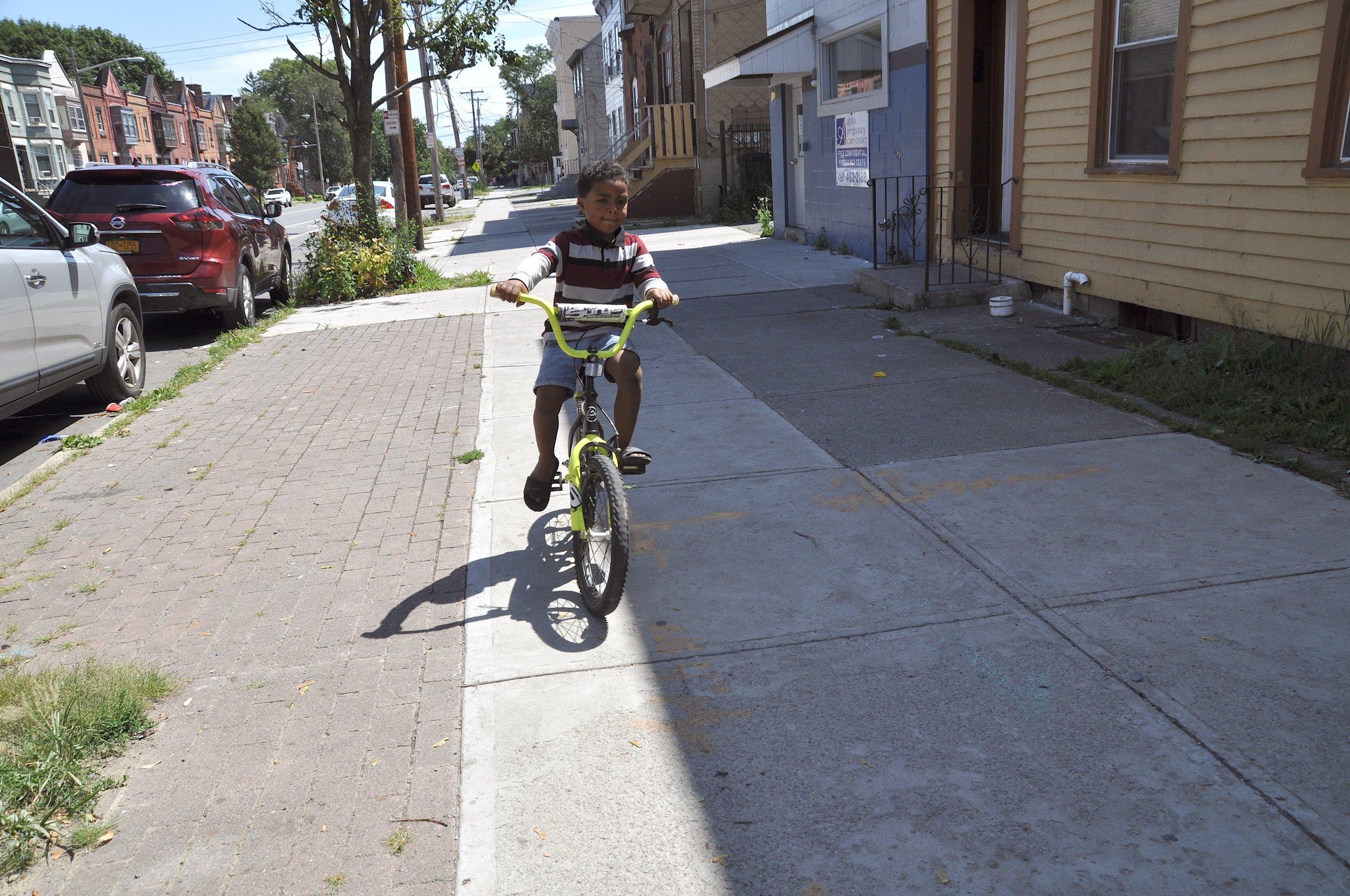 Sidewalk Biker T.JPG