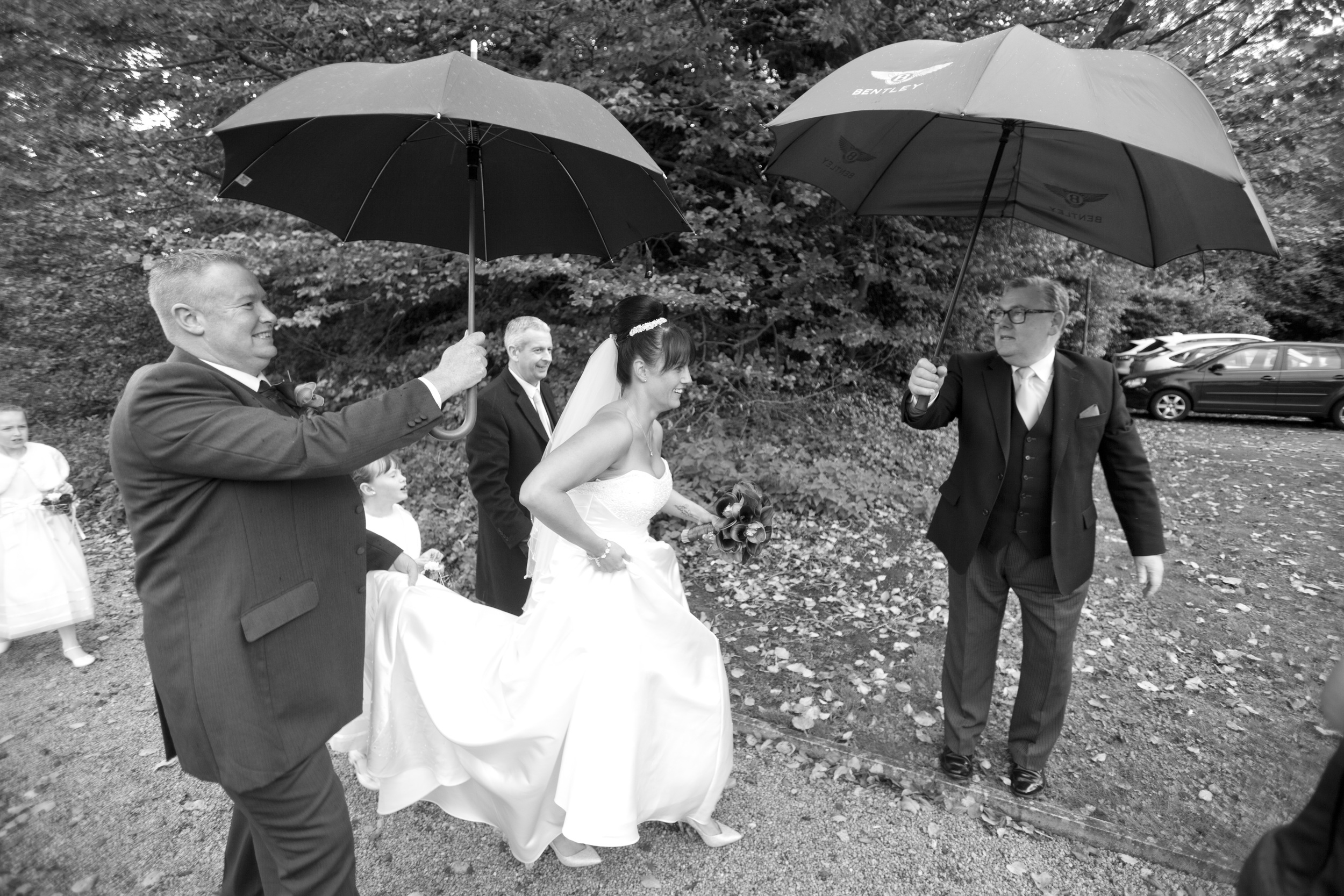 bride with umbrella rain