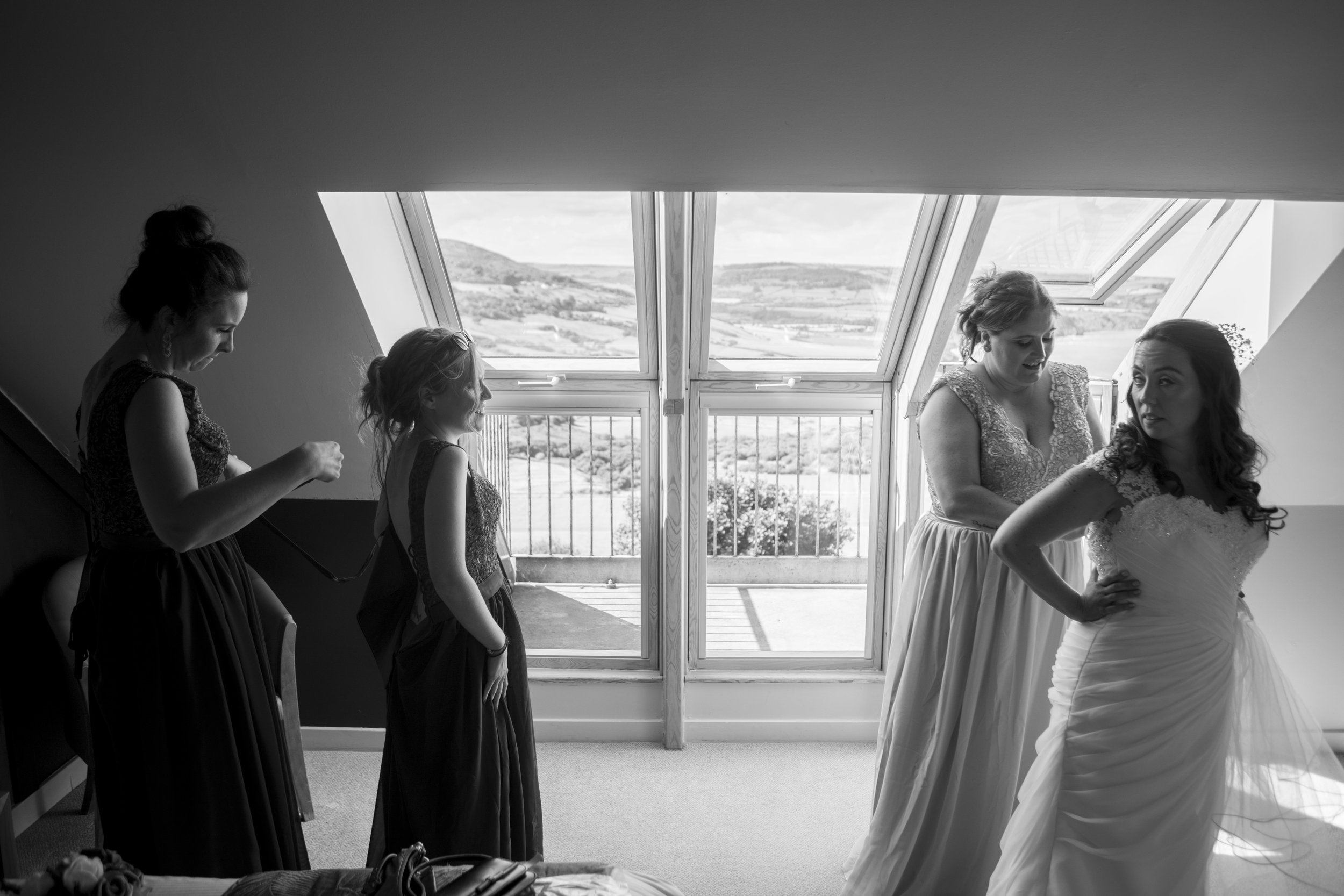 bridesmaids and the bride getting ready