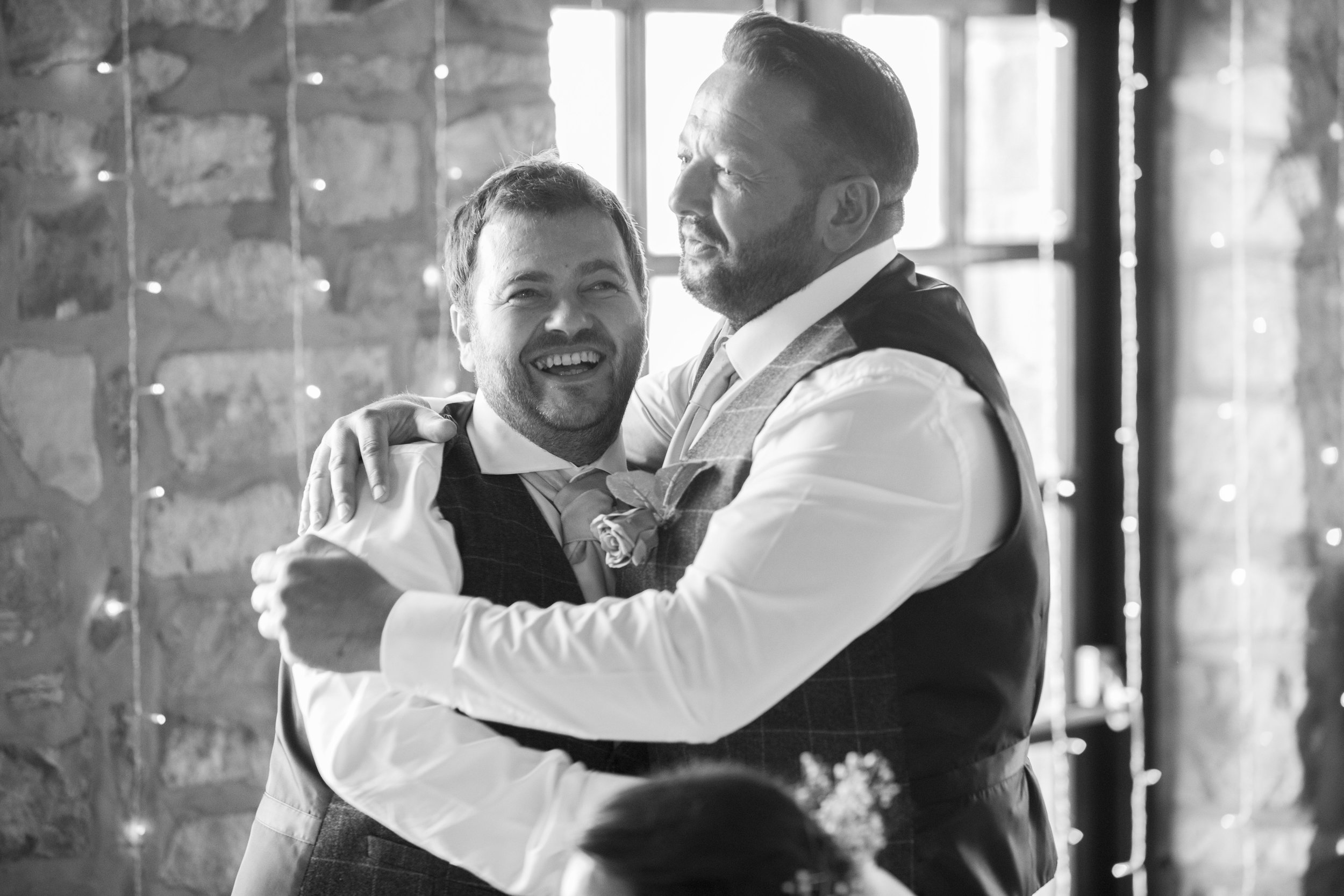 groom and his best man laughing
