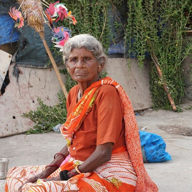 A regal elder from the fishing village chatting with other women #regal #women #fishingvillage #urbexphotography #street