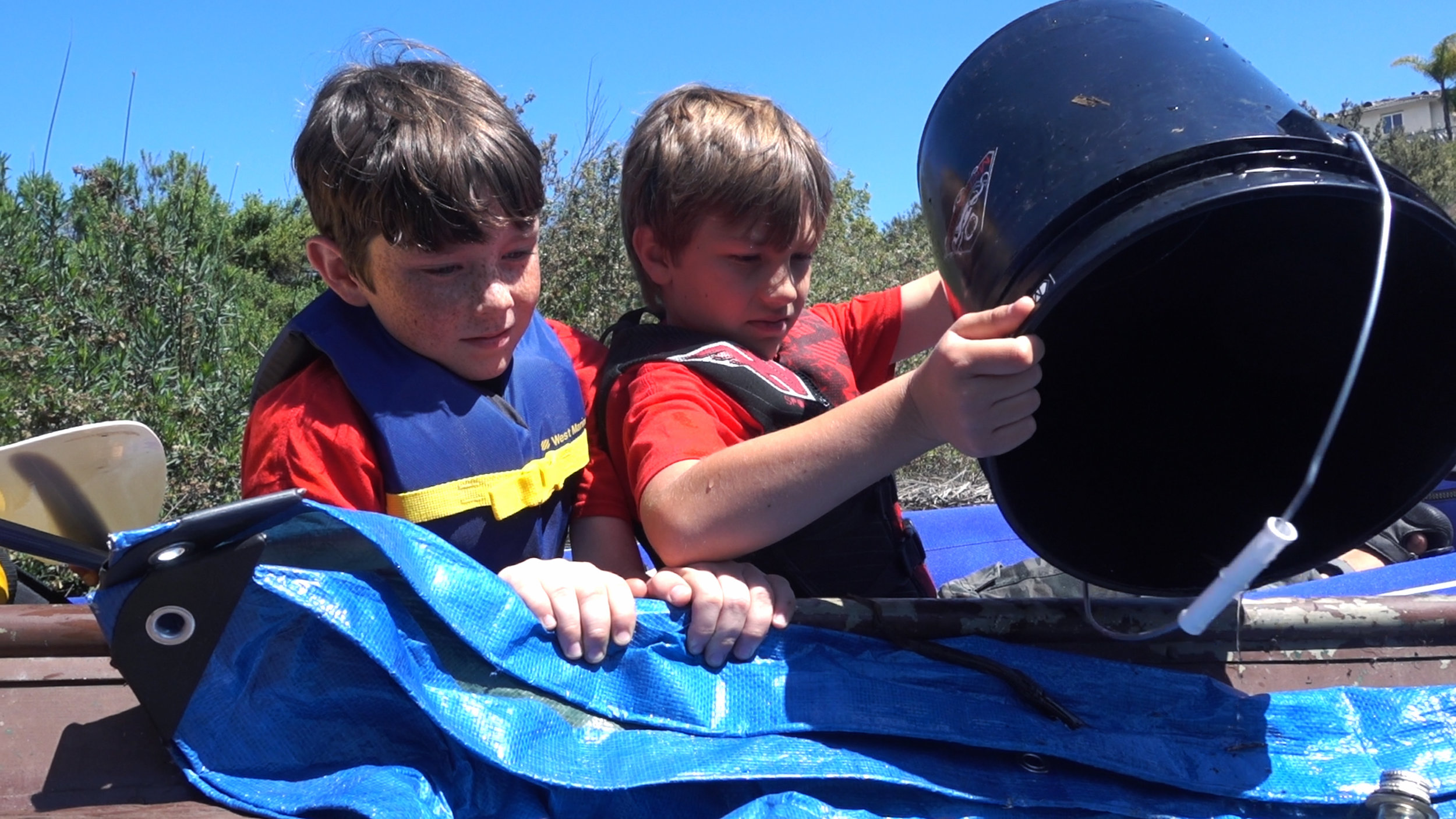Cleanup Pond - Dumping trash bucket with Microactivist friend Jonah Wright.jpg
