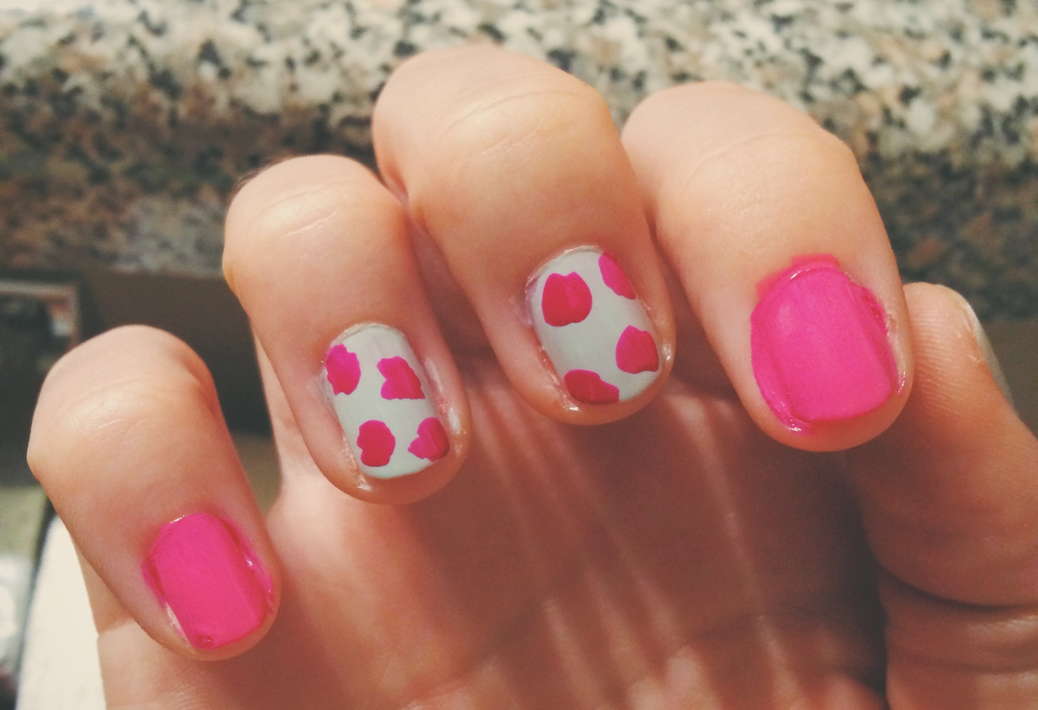 """Create four messy 'flowers' on each green nail using """"Koala Bear-y"""". Make sure your brush doesn't have too much polish on it or you'll end up with chunky blobs. It's always easier to add more paint than try and remove it!"""