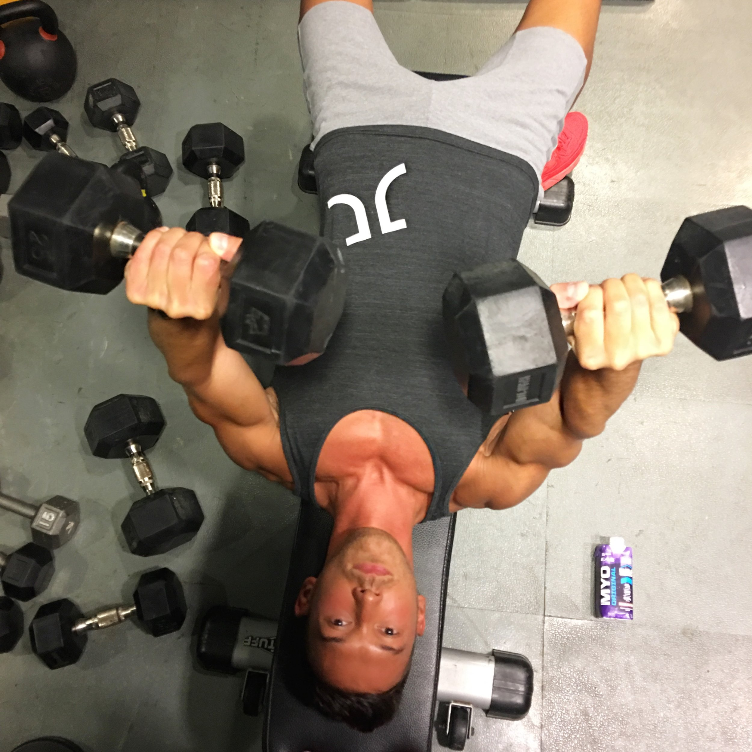 Jason Tran, doing dumbbell chest presses for time (goal:  30+ reps in 60 seconds).