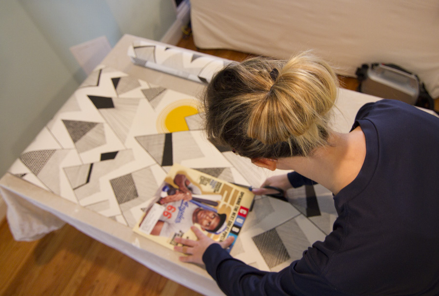 Chloe cutting wallpaper with scissors
