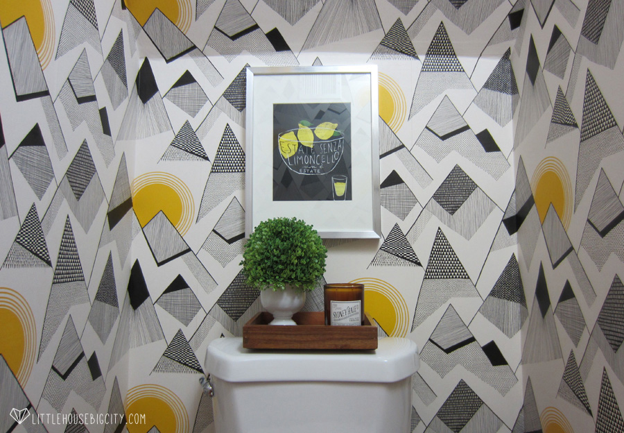 Mountains by Missprint wallpaper makes this powder room pop