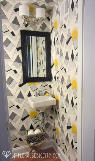 Mountains by MissPrint wallpaper makes this powder room pop.