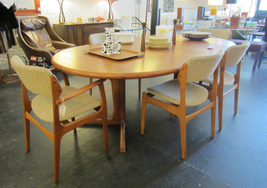 Danish modern round to oval teak dining table by Dyrlund circa 1960s / 1970s