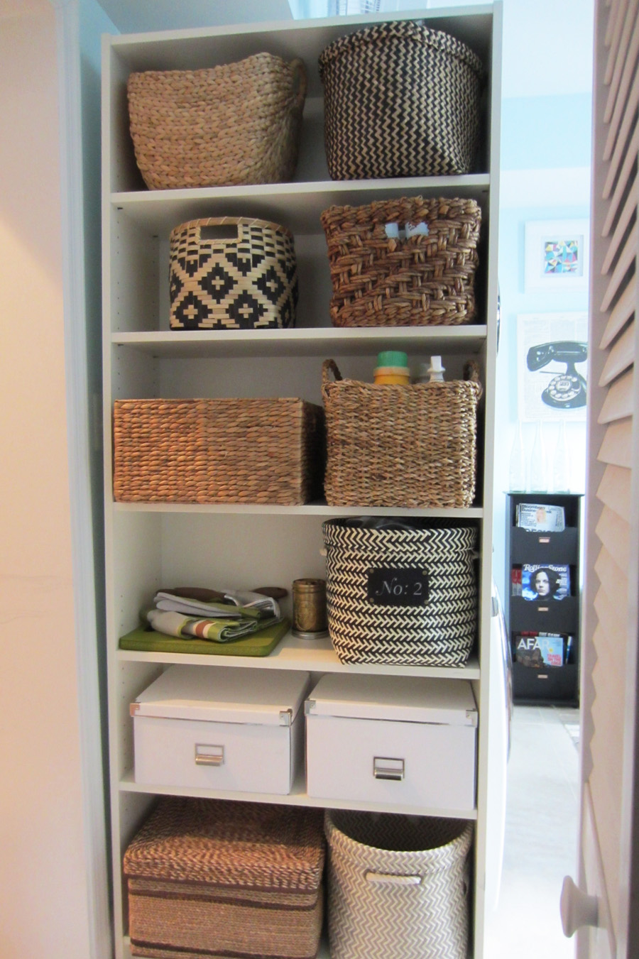 Billy Bookcase filled with baskets for pretty storage