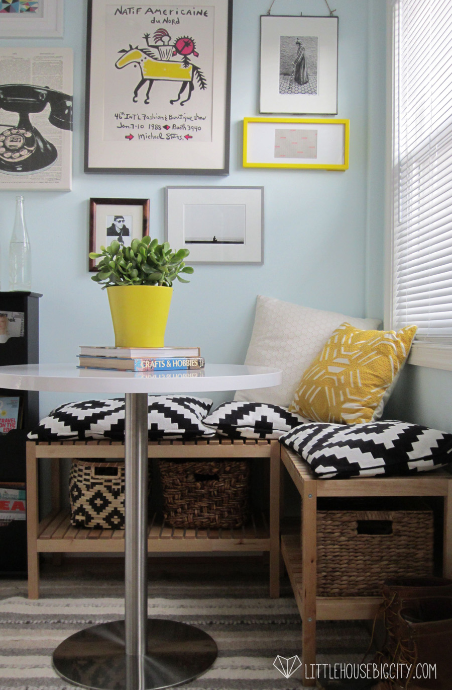 Sunny breakfast nook with gallery wall and Ikea benches