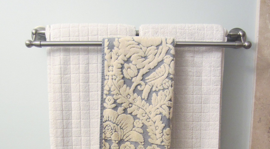 Double bar towel rack leaves room to expand my linen collection