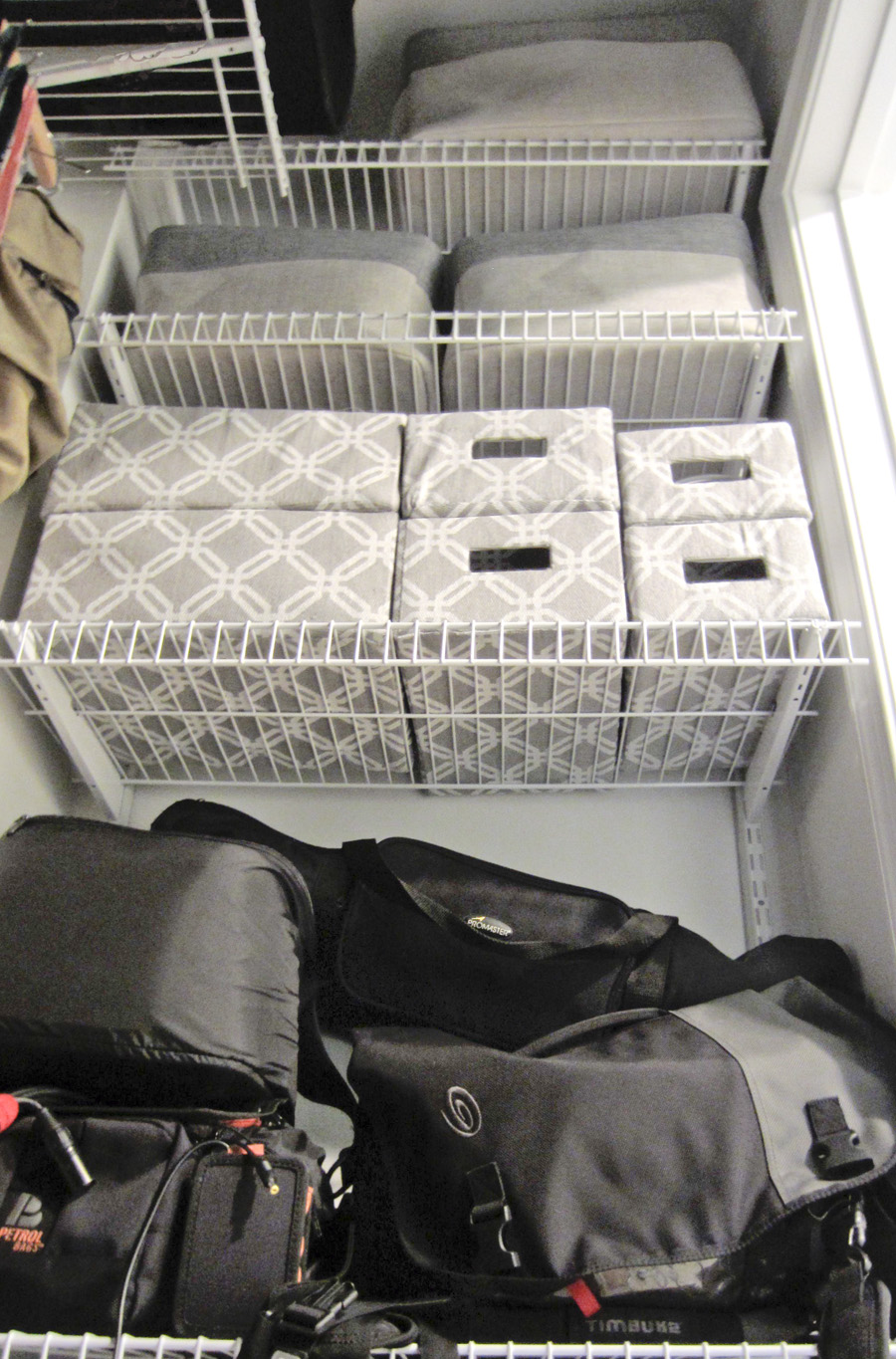 Eli's camera gear is organized in bins and bags