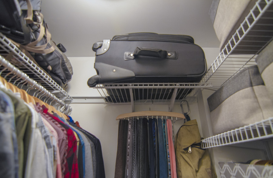The top shelves in Eli's closet go to his once-in-a-while items