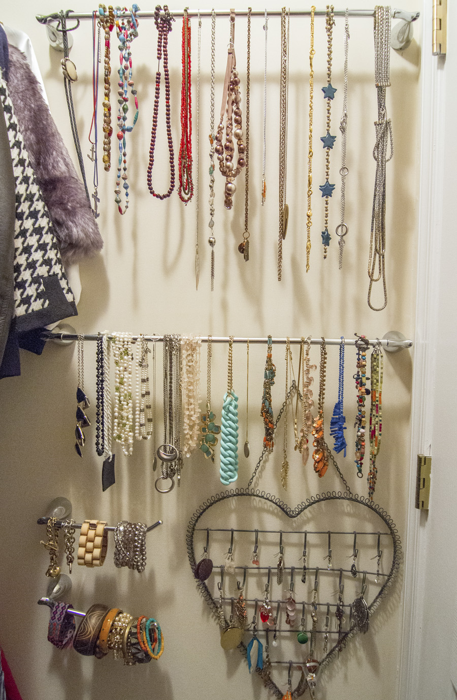 Towel and toilet paper racks are re-purposed for jewelry organization