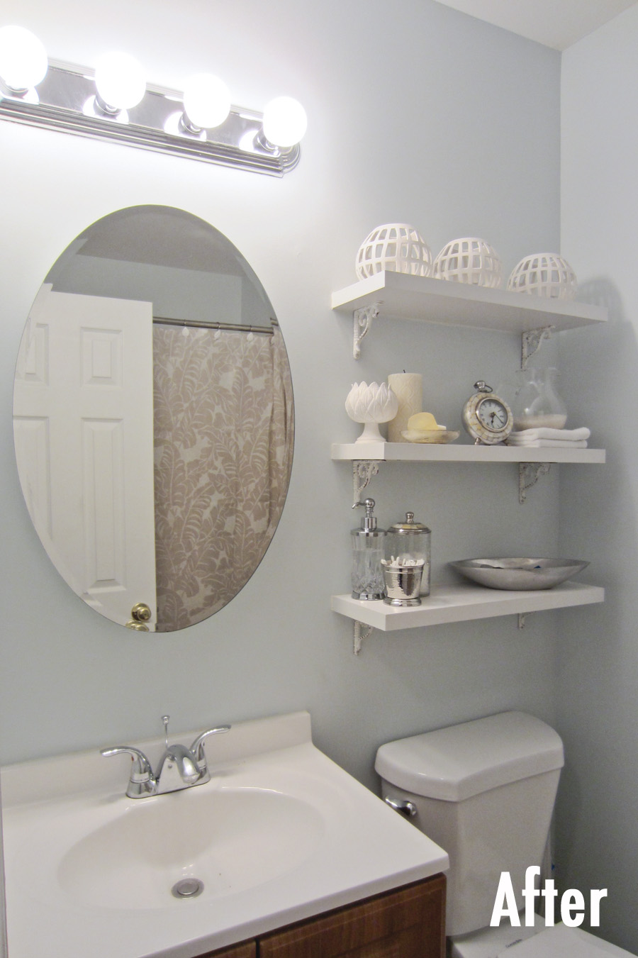 After: A thrifted medicine cabinet brings a bit of elegance to a small bathroom