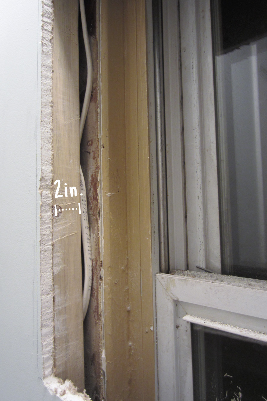 The 2x4 was rotated to accommodate the window that was in the way of the stud