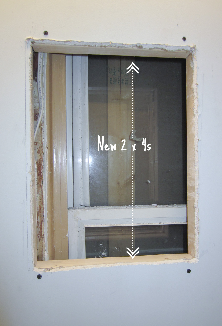 We screwed in new 2x4s at the top and the bottom of the hole