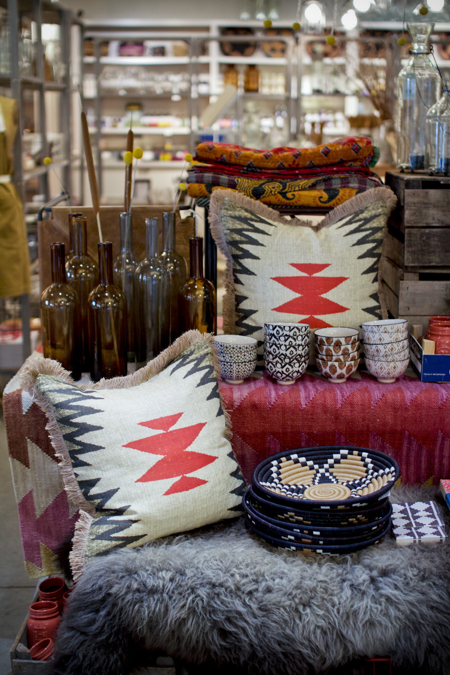 I love the tribal/aztec vibe of these pillows and the pretty pinks and reds in the rug behind it.