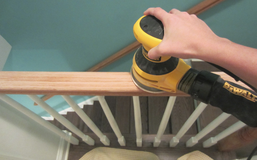 I used the DeWalt orbital hand sander to remove most the finish on the stairwell