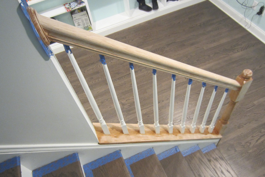 I taped around the steps and balusters to protect the surfaces while staining and painting