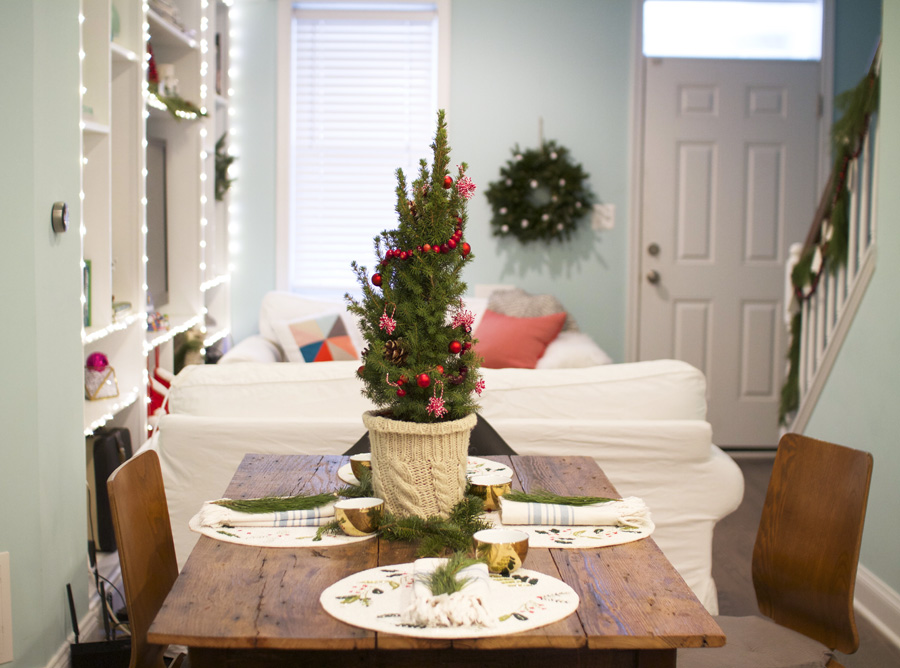 A mini Christmas tree on the dining table does the trick when you don't have space for a full-size tree