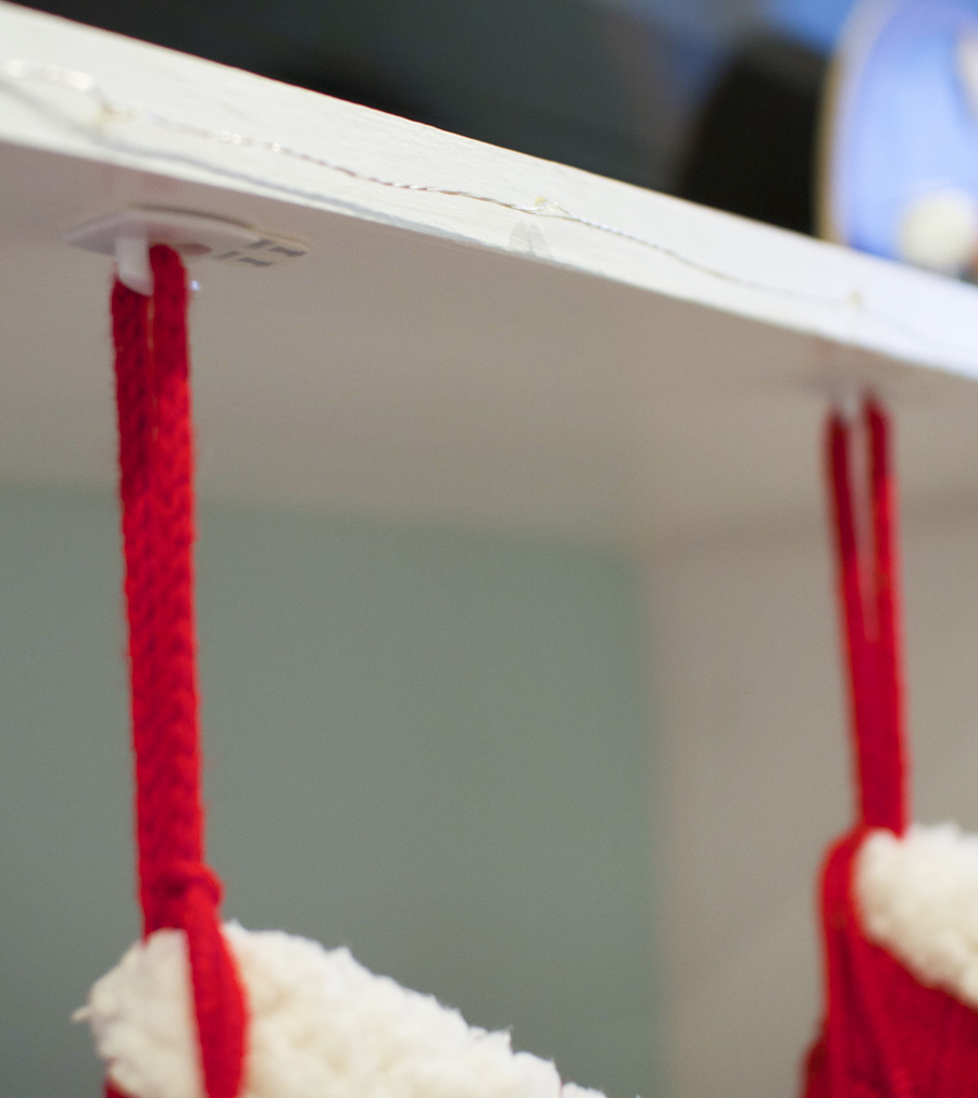 3M Command hooks save the day! They're small decorating clips are great for hanging stockings.
