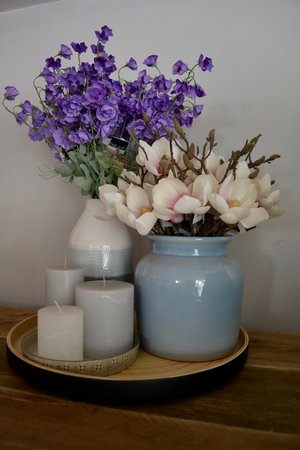 Black matt lacquer bamboo tray £36 |Grey patterned serving dish £9.99 | Assorted candles price from £4.50 | Tall three tone vase £21.95 | Blue galzed pot £34.99 | Artifical sweet pea £9.99 per stem | Artificial magnolia £7.49 per stem