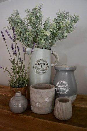 Tall Milk jug £44.95 | Artificial lavender plant £22.99 | Italian style grey pot with lid £34.99 | Honeycomb and bee stone planter £10.99 | Concrete geometric tea light holder £7.95 | Grey glazed bottle vase £8.99