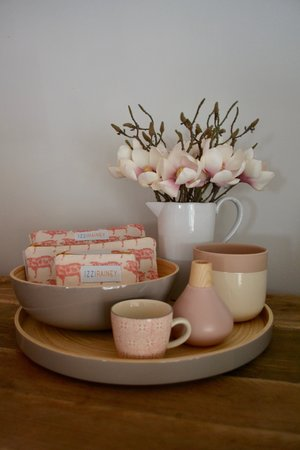 Grey lacquer bamboo tray £36 | Grey lacquer bamboo bowl £26 |Izzi Rainey Pig print in 3 sizes - Coin purse £8 Make up case £14 Wash bag £18 | White pitcher jug £17.99 |Artificial magnolia £7.49 per stem | Cream and pink two-tone planter £12.95 | Cork glazed vase in pink £12.95|Patterned tea-cup £6.95