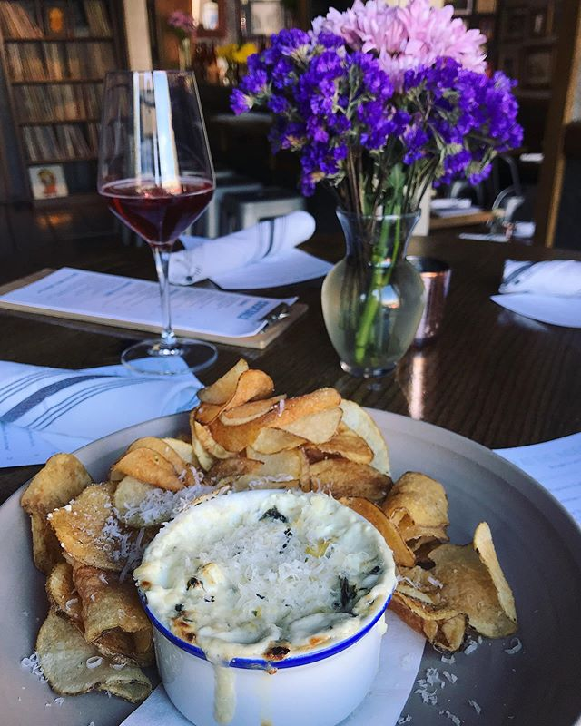 Spinach and artichoke dip, done the right way — with local spinach from @whocooksforyoufarmpa and served with fresh fried chips, and fresh grated parm.  And why not have a glass of sparkling rosé?