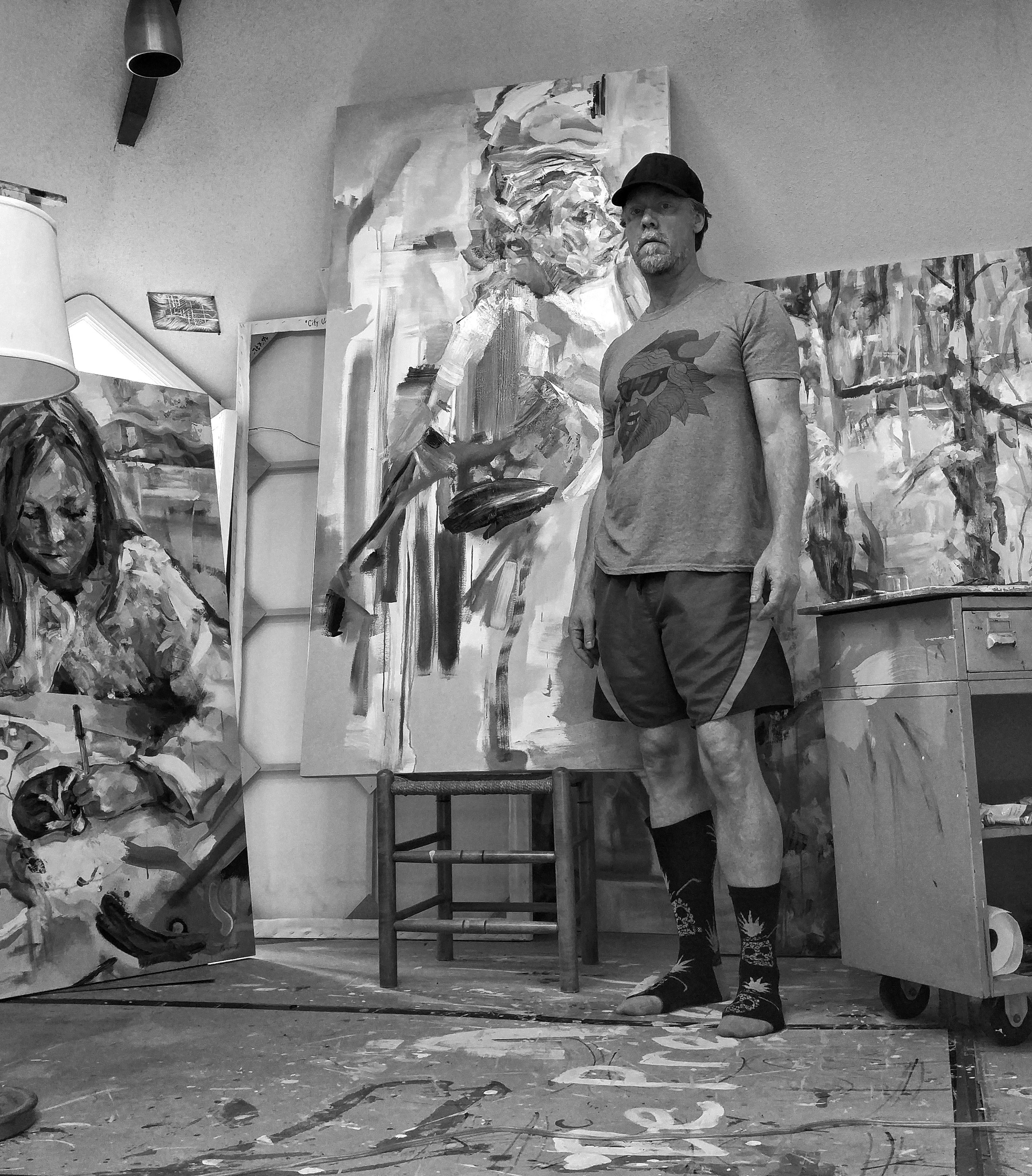 Standing in my art studio beside some paintings in progress.
