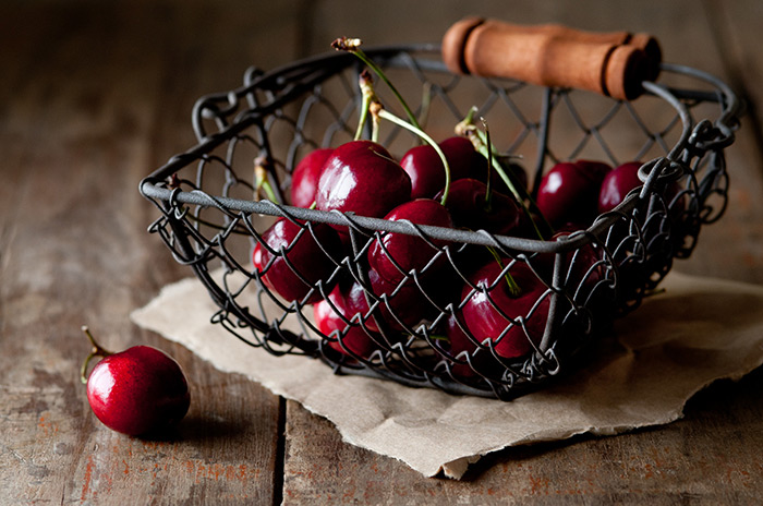 Fresh Cherries in a Wire Basket Food Stock Photo