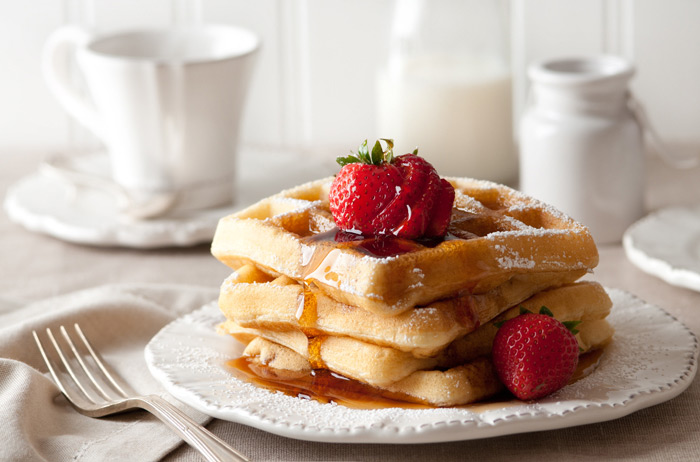 Waffles with Syrup and Strawberries Food Stock Photo