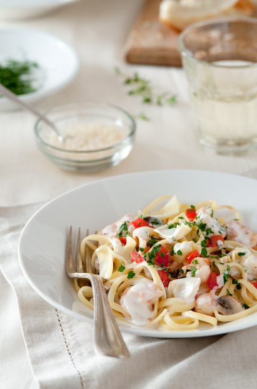 Seafood Pasta with Tomatoes and Artichoke Hearts Stock Food Photo