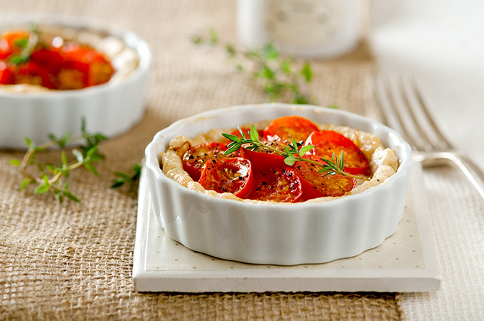 Tomato Tarts with Gruyere Cheese Stock Food Photo