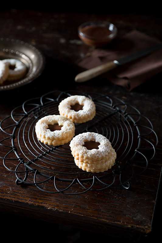 Orange Linzer Cookies with Grand Marnier Chocolate Ganache Stock Food Photo