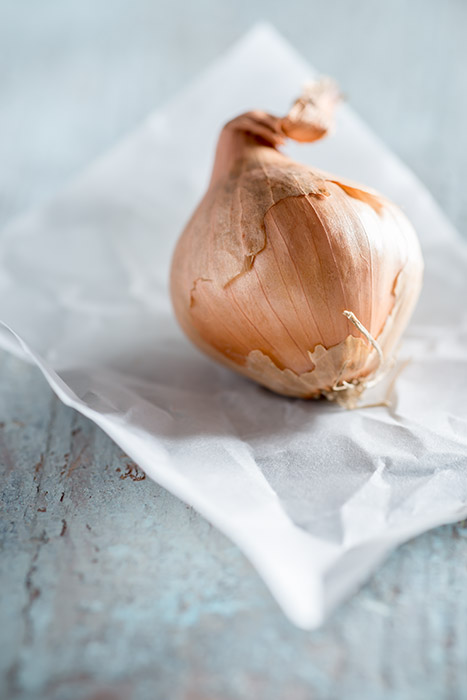 Raw Shallot on Paper Stock Photo