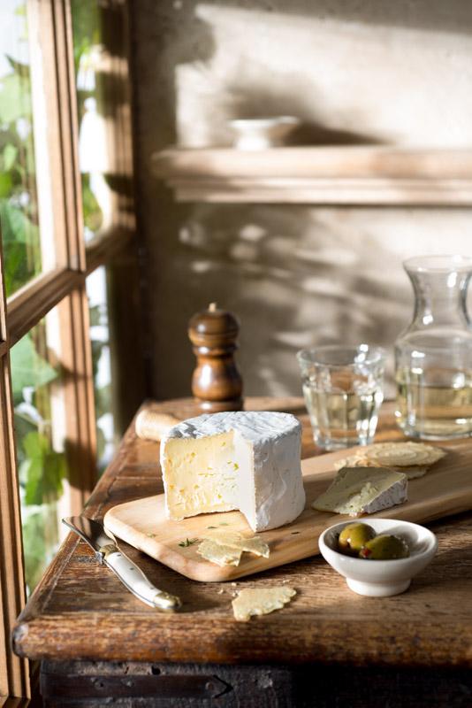 Wine and Cheese Farmhouse Still Life Stock Photo